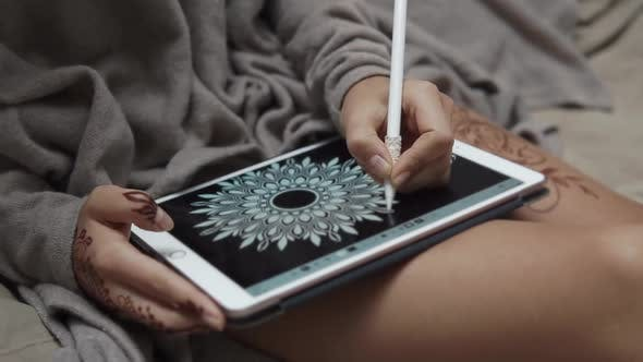 Woman Drawing on a Tablet