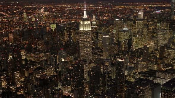 Thumbnail for Establishing Shot of High Rise Buildings in New York City at Night