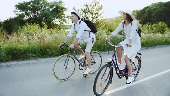 Thumbnail for Couple Riding Bicycle on Countryside Road