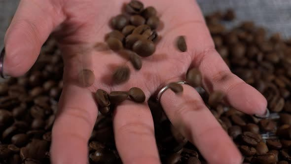 Grains Fall Into the Woman's Hand