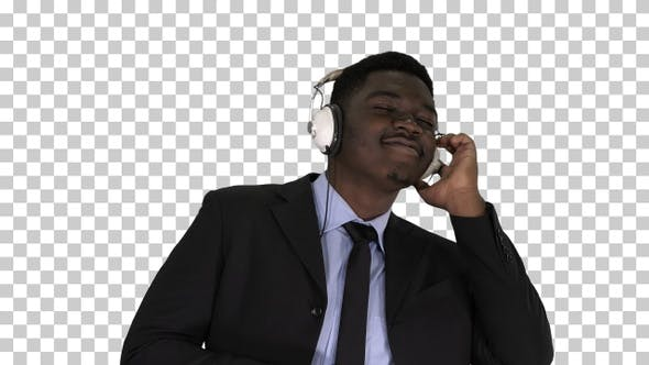 Thumbnail for Black businessman dancing to music in headphones, Alpha Channel