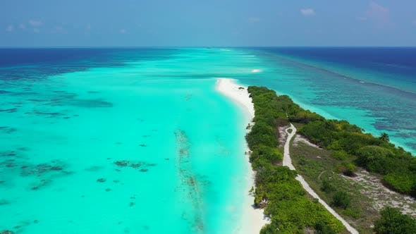 Natural drone tourism shot of a sunshine white sandy paradise beach and aqua turquoise water