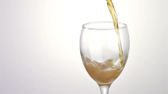 Beer Tapping, Draft Beer into a Wine Glass Isolated on White Background