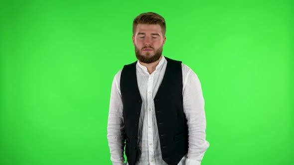 Thumbnail for Man Stands Waiting with Boredom. Green Screen