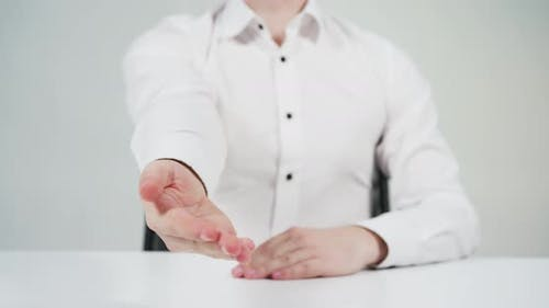 Man giving hand to close a deal