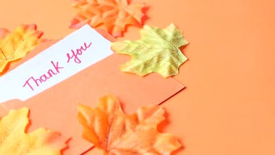 Thank You Message and Envelope on Orange Background