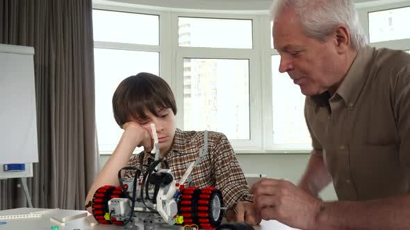 Thumbnail for Senior Man Finds the Part of the Toy Vehicle for His Grandson