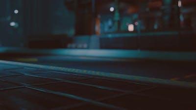 Futuristic Street with Neon Glow at Night