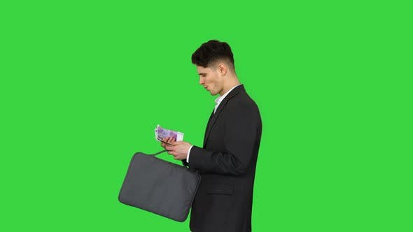 Thumbnail for Young Business Man Walking Counting Euro Bills on a Green Screen, Chroma Key