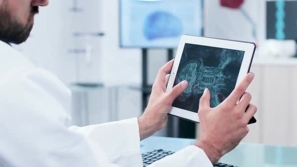 Thumbnail for Doctor Looking and Analyzing X Ray on a Digital Tablet Pc Screen