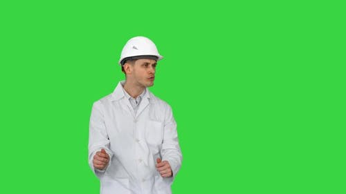 Engineer Man Dancing in Funny Way on a Green Screen, Chroma Key.