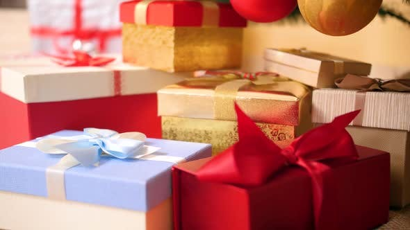 Thumbnail for Closeup Footage of Lots of Colorful Boxes with Gifts and Presents Decorated with Ribbons and Bows
