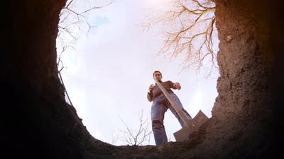 A Man Digs a Grave