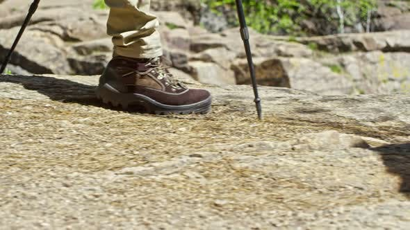 Thumbnail for Travelers with Trekking Poles Walking