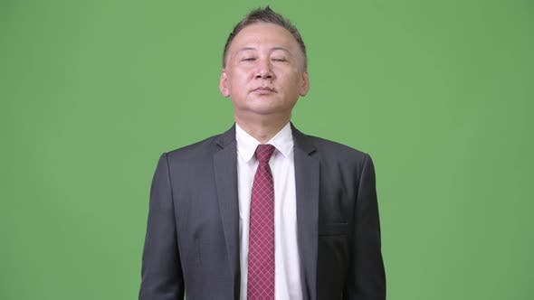 Mature Japanese Businessman Relaxing