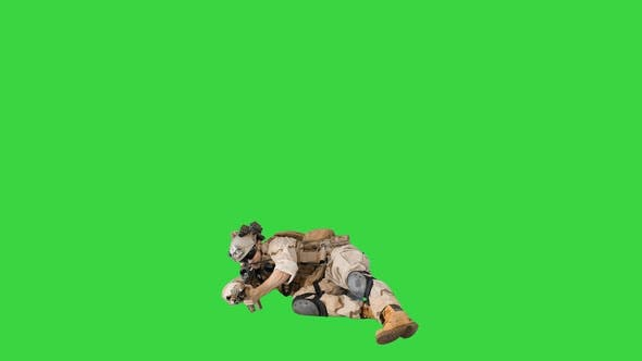 Thumbnail for Soldier Firing From Lying Position on a Green Screen, Chroma Key