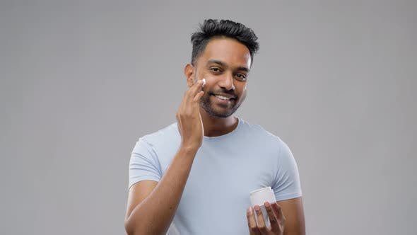 Thumbnail for Happy Indian Man Applying Cream To Face 42