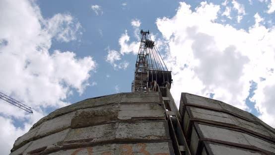 Crane Rotate at Building Construction Site, Architecture Apartments, Wide Shot