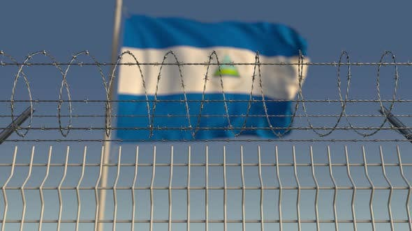 Thumbnail for Waving Flag of Nicaragua Behind Barbed Wire