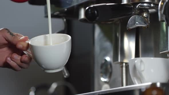 Cover Image for Barista Pouring Steamed Milk into Coffee Cup for Cappuccino