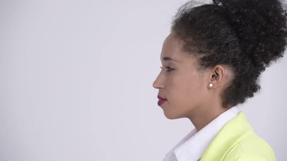 Cover Image for Closeup Profile View of Young Beautiful African Businesswoman