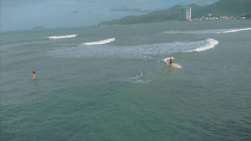 Athletic Young Women and Men Surf, Ride Big Waves with Bright Daylight, Surfer