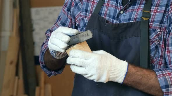 Thumbnail for Carpenter Working with Wooden Bar in Workshop