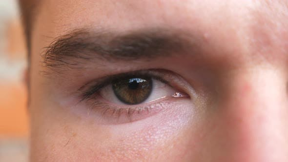 Thumbnail for Close Up Brown Eye of Guy Staring and Blinking with a Disappointment Sight