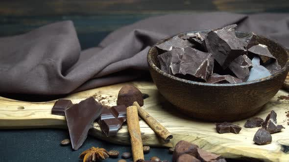 Thumbnail for Dark or Milk Organic Chocolate Pieces and Truffle Candies in Wooden Bowl on Dark Concrete Background