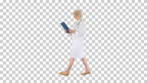 Female senior therapist walking with a, Alpha Channel