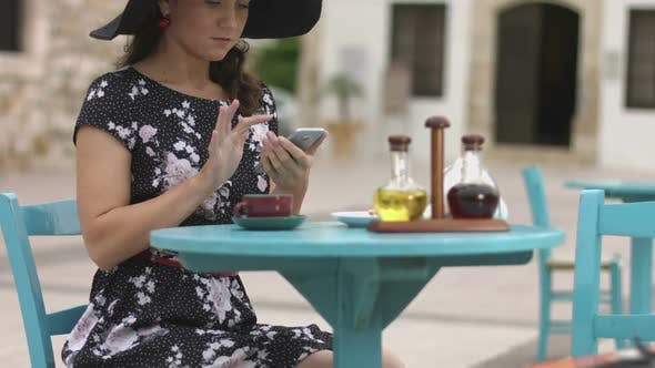 Thumbnail for Beautiful Female Tourist Typing Message, Chatting Online on Smart Phone in Cafe