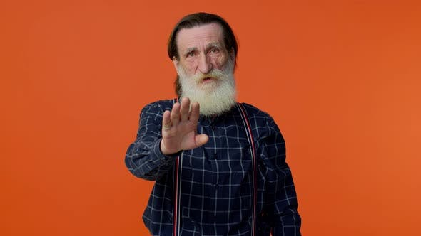 Elderly Bearded Grayhaired Man Say No Stop Gesture Warning of Finish Prohibited Access Declining