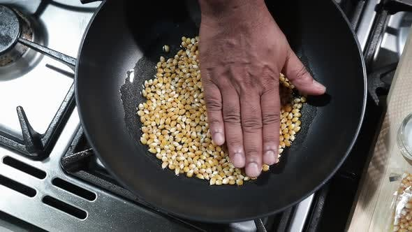 Patting Corn Kernels