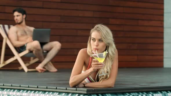 Thumbnail for Sexy Woman Drinking Cocktail in Swimming Pool. Portrait of Blonde Woman