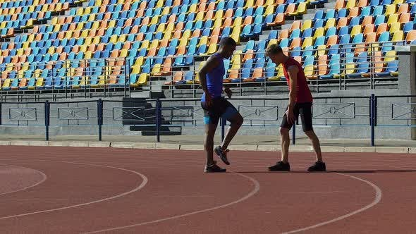 Thumbnail for Coach Helping His Sportsman to Warm up And Control His Workloads at Training