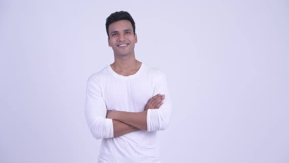 Thumbnail for Happy Young Handsome Indian Man Smiling with Arms Crossed