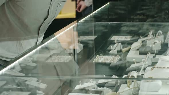 Cover Image for Man Choosing Engagement Ring on Luxury Shop Display