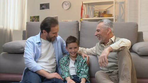 Happy Grandfather Enjoying Pastime With His Son and Grandson, Slow-Motion