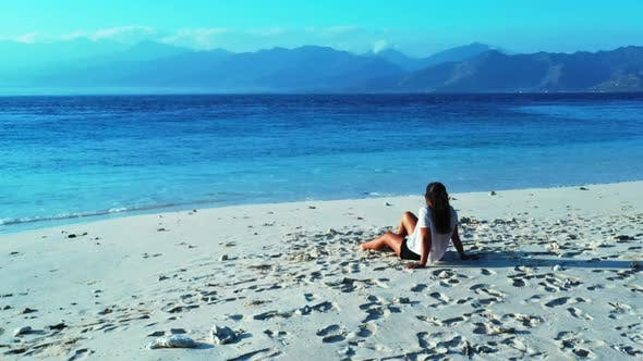 Thumbnail for Ladies tan on marine resort beach vacation by shallow ocean with bright sandy background of Gili Air