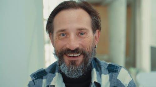 Portrait of Smiling Senior Adult Man with Beard