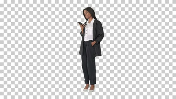 Thumbnail for Smiling black woman texting on her cell phone, Alpha Channel
