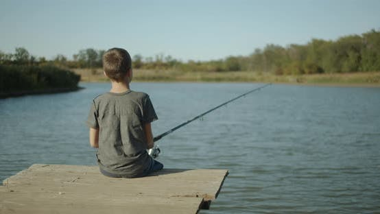 Thumbnail for A Little Boy Holding a Fishing Rod. Fishing Concept
