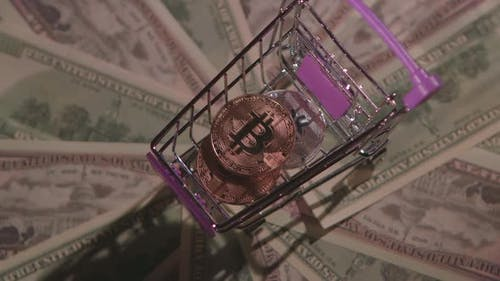 Money Coin Bitcoin in a Small Cart Turns