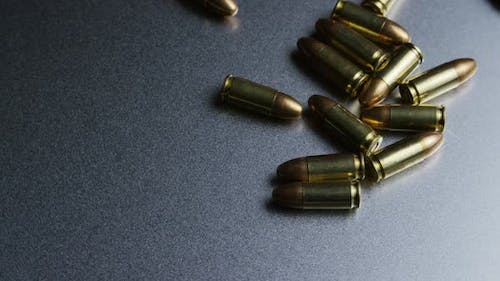 Cinematic rotating shot of bullets on a metallic surface - BULLETS 043