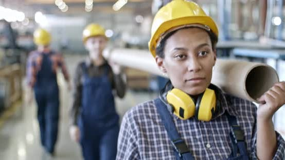Thumbnail for Female Workers Carrying Pipe