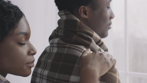 Young African American Man Looking at Window His Loving Girlfriend Embracing His Back Enjoying