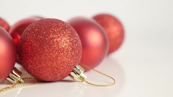 Thumbnail for Red decoration baubles for Christmas holiday slow tilt 4K video