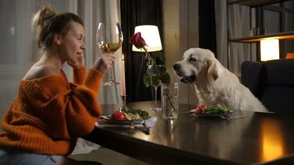 Thumbnail for Loving Female Owner Raising Glass for Pet's Health