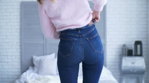 Thumbnail for Overweight Woman Fitting in Tight Jeans in Bedroom