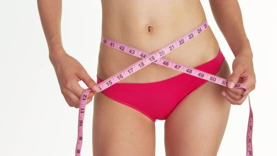 Cover Image for Sexy woman measuring waist